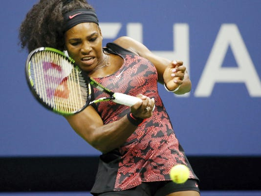 Defending champion Serena Williams, of the United States, returns a ball during her first-round match against Vitalia Diatchenko, of Russia, at the U.S. Open tennis tournament in New York on Monday.