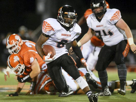 Northeastern's Anu Johnson runs down the field during Friday's game against Central York. Johnson finished with 14 carries for 110 yards and a touchdown as the Bobcats shut out the Panthers, 42-0.