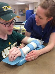 Josh Speidel works with his therapist at The Rehabilitation Hospital of Indiana in Indianapolis.