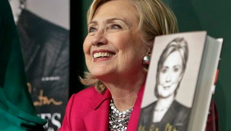 """HiIlary Rodham Clinton listens before signing a copy of her book, """"Hard Choices"""" on June 10 at Barnes and Noble bookstore in New York."""