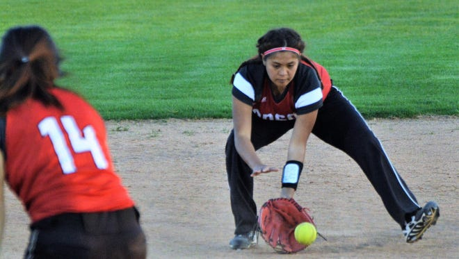 Anson shortstop Nayelli Moreno fields a fifth-inning ground ball as as pitcher Elissa Lozoya (14) watches from the pitching circle in Tuesday's 18-8 loss at Brownwood.