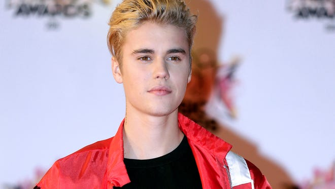 FILE - In this Nov. 7, 2015 file photo, Justin Bieber arrives at the Cannes festival palace in Cannes, southeastern France. Justin Bieber could add another five MTV EMA European music awards to the five he won last year. Bieber is tied with Beyonce for the most nominations at the awards show Sunday, Nov. 6, 2018, in the Dutch port city of Rotterdam. (AP Photo/Lionel Cironneau, File)