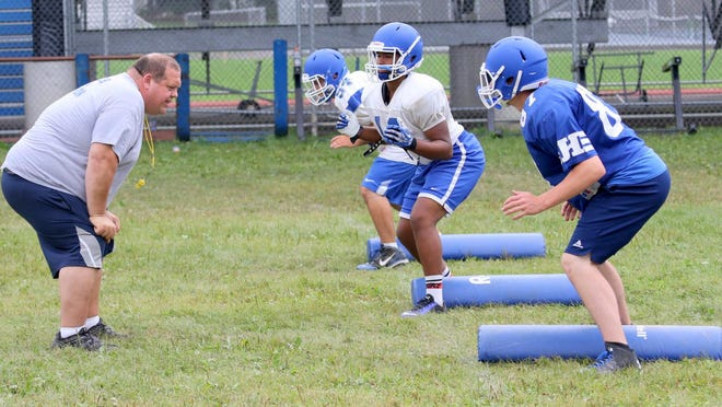 Horseheads head coach Damian Saks works with players during a practice in 2015.