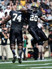 Vanderbilt defensive lineman Jay Woods (74) and safety