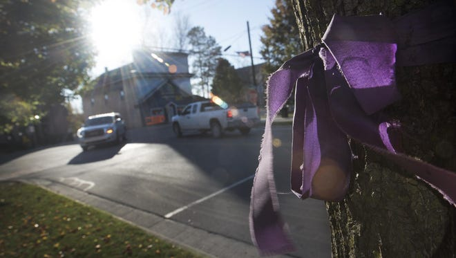 A purple bow still hangs on some of the trees in downtown Maybee, two years after Chelsea Bruck disappeared from a Halloween party.