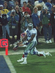 Dallas Cowboys defender Leon Lett (78) has the football stripped from his hand Jan. 31, 1993, by Buffalo Bills' Don Beebe as he nears the goal line with a recovered fumble in the fourth quarter of Super Bowl XXVII in Pasadena, Calif.