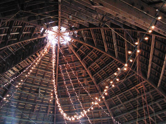 Looking up from the loft level, you can see the eight laminated wooden ribs which support the barn roof. Lights are sometimes strung for receptions.