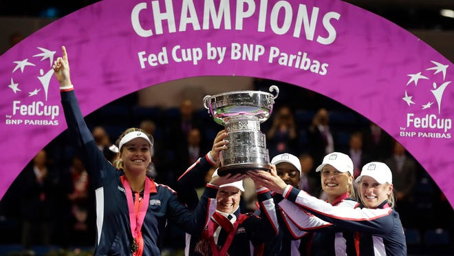 United States' team celebrates during the awarding ceremony after winning the Fed Cup final match between Belarus and USA, in Minsk, Belarus, Sunday, Nov.12, 2017. United States defeated Belarus 3-2 and gained the Fed Cup title. (AP Photo/Sergei Grits)