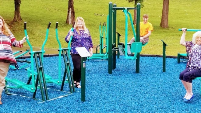Sarah Casseday, Jessica Coe, Rob Winter, and Mayor Carolyn Rader worked together to make the exercise park a reality.