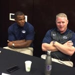 Nevada running back Don Jackson, left, and coach Brian Polian laugh while talking to reporters Tuesday at the Mountain West's football media days in Las Vegas. Polian and other coaches expressed concern that the NCAA rule allowing schools to pay scholarship athletes the full cost of attendance will widen the gap between the top programs in college football and all of the others.