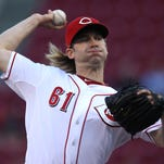 Reds starting pitcher Bronson Arroyo delivers in September of 2013.