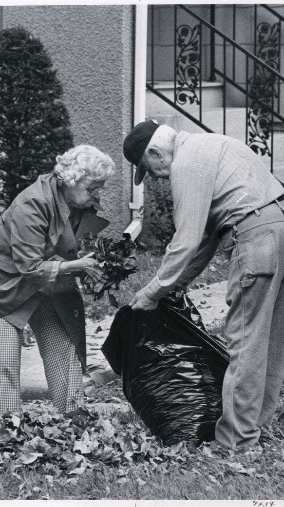 Marvin Pool (right) helps his neighbor, Macie Blackwell,