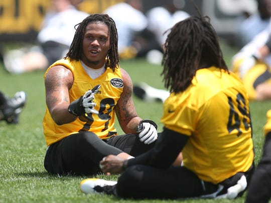 Pittsburgh Steelers linebacker Keion Adams (99) talks with linebacker Bud Dupree (48) during drills in minicamp at the UPMC Rooney Sports Complex.