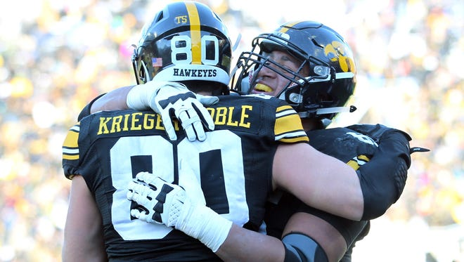 Henry Krieger Coble (80) is greeted first by his roommate and best friend, Jordan Walsh, after he scored a touchdown in Kinnick Stadium for the first time on Nov. 21 against Purdue.