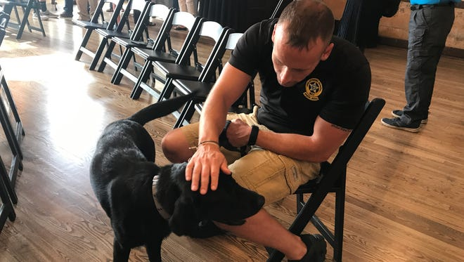 Josh Rammel, a special agent for Ohio's Bureau of Criminal Investigation, graduates from handler training Aug. 3, 2017, with his new partner, Reptar.