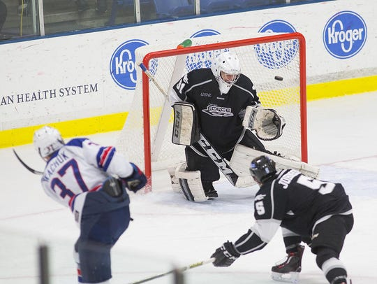 Brady Tkachuk (No. 37) scores during the second period