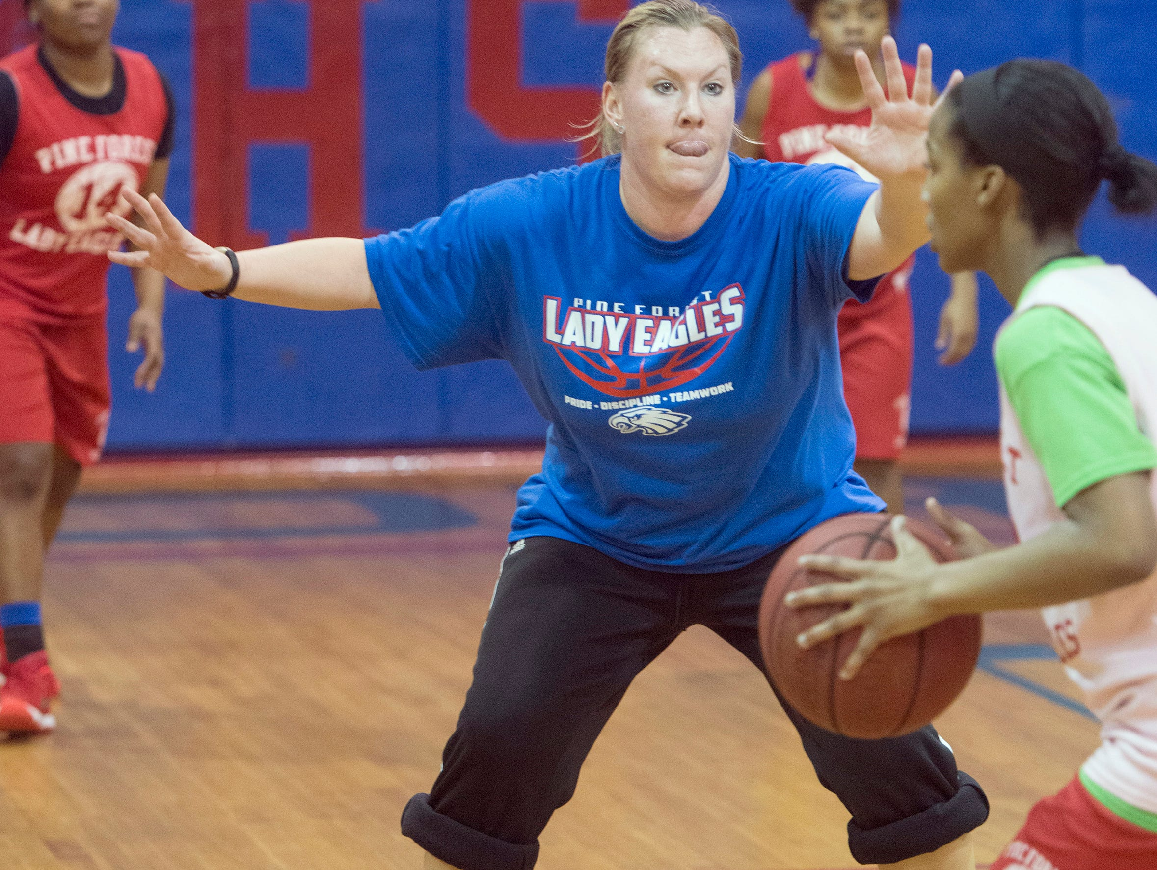 Pine Forest High School Girls Basketball coach, Zaria Williams, works out with her team as it prepares for the upcoming district 1-6A tournament.
