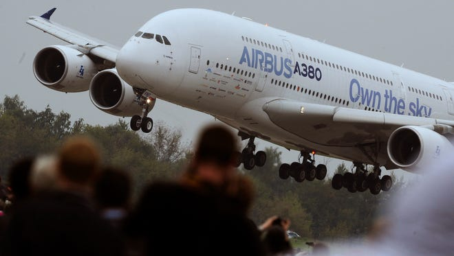 Visitors watch an Airbus A380 landing at the  the MAKS Air Show in Zhukovsky outside Moscow on Aug. 30, 2013.