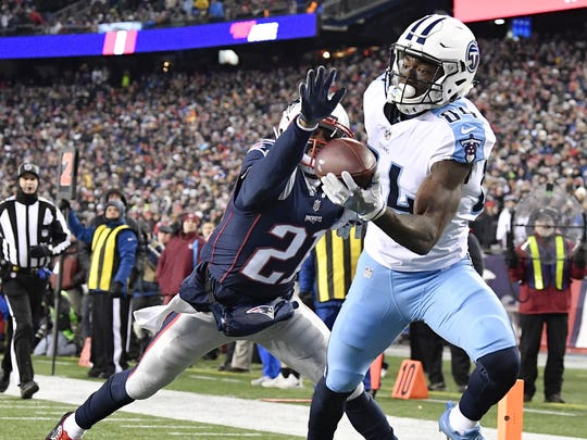 Titans wide receiver Corey Davis (84) scores the team's first touchdown during the first half of the AFC divisional playoff game last season.