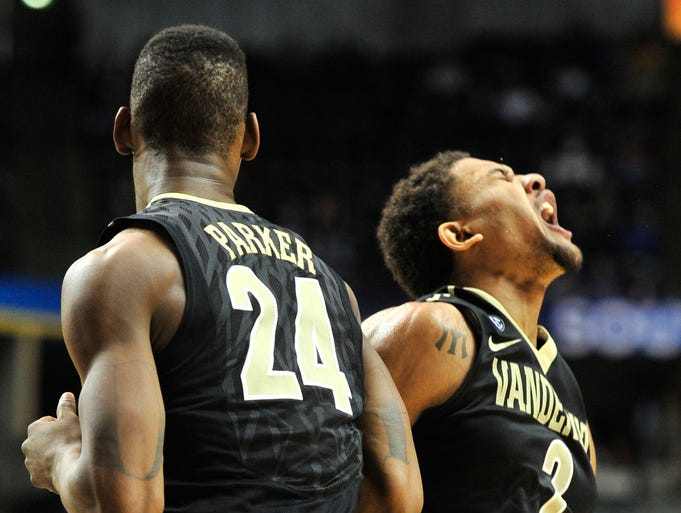 Vandy players Dai-Jon Parker (24) and (2) Kendron Johnson celebrate after a call in the SEC tournament at Bridgestone Arena on Saturday, March 16.