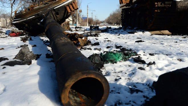 The wreckage of a Ukrainian army tank sits in Uglegorsk near Debaltseve on Feb. 18, 2015.