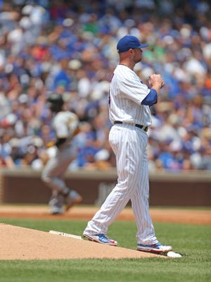 Jon Lester was charged with four earned runs and six hits.