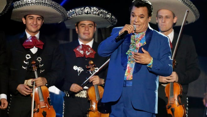 In this April 28, 2016, file photo, Mexican singer Juan Gabriel performs during the Latin Billboard Awards in Coral Gables, Fla.