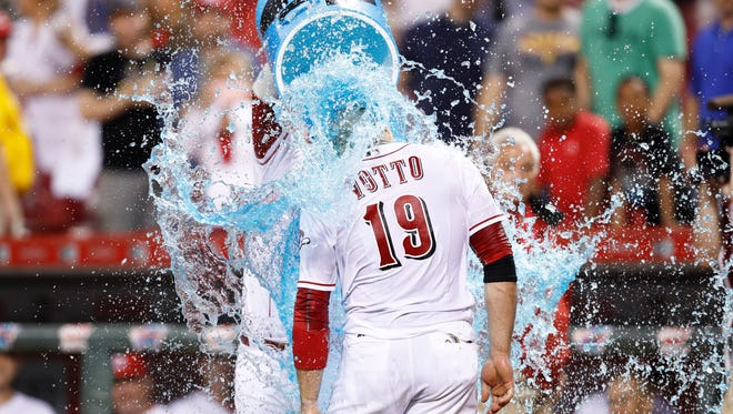 Joey Votto #19 of the Cincinnati Reds is doused with Powerade after hitting the game-winning home run against the St. Louis Cardinals in the ninth inning of the game at Great American Ball Park on June 7, 2016 in Cincinnati, Ohio. The Reds defeated the Cardinals 7-6.