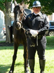 Former Rutherford County Sheriff's Office Sgt. John Levi stands with CC, his partner on the Mounted Patrol Unit, which Levi created in 1998.