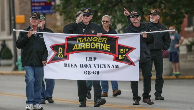 The Indiana Rangers Veterans of the Vietnam War, the mose decorated unit of 1969, march in the Veterans Day Parade in Indianapolis, Friday November 11, 2016.