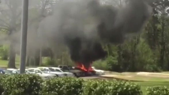 A vehicle burns on the Tougaloo College campus.