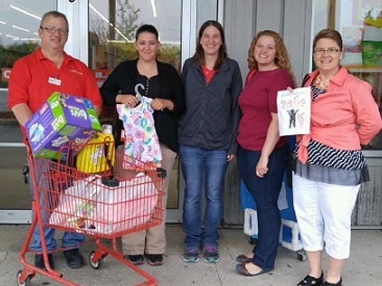Family Dollar, located on South Main Street in Fond du Lac, created a collection of baby clothes and items for Jennifer Holstein. Pictured are, from left: Family Dollar Manager Shawn Lally, Holstein, former Family Dollar Clerk Miranda Clark, Amber Bose and Connie Millard.