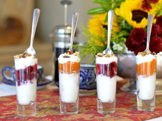 Greek yogurt layers with cranberry sauce and leftover pumpkin pie in these breakfast parfaits served in shooter glasses.