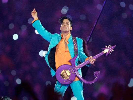 FILE - In this Feb. 4, 2007, file photo, Prince performs during the halftime show at the Super Bowl XLI football game at Dolphin Stadium in Miami. The Grammy Awards announced Wednesday Feb. 8, 2017, that Sunday's show will include tribute performances in honor of Prince and George Michael. Both stars died last year.