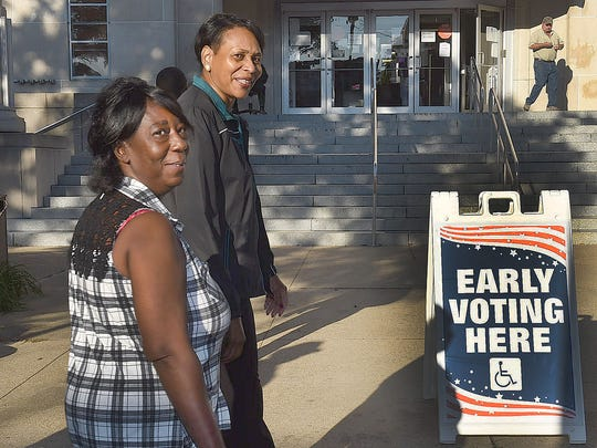 Opelousas residents arrive at the St. Landry Parish Courthouse to cast their vote early for the November 8 elections. Early voting began at 8:30 a.m. and continues through November 1, excluding weekends and holidays. See more photos on Facebook.