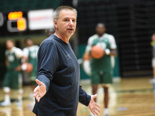 Coach Larry Eustachy gives instructions to his players during a practice last season.
