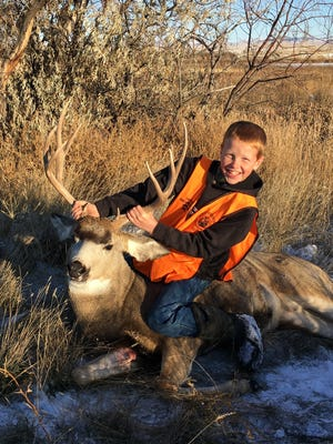 Jayton Ophus shot his first deer while hunting with his father near Big Sandy.