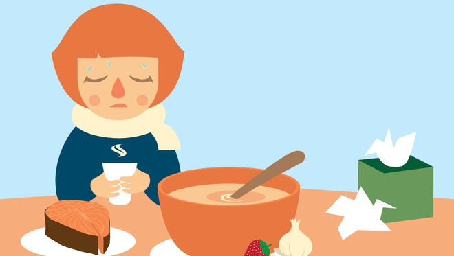 Chicken soup, berries, wild salmon, tea and garlic are good flu fighting foods.
