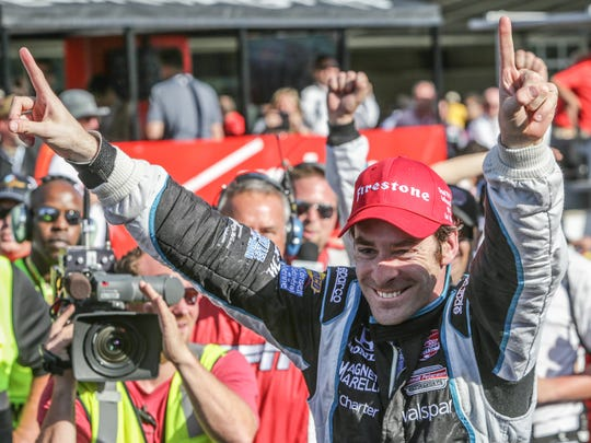 Simon Pagenaud celebrates winning the inaugural Grand Prix of Indianapolis at the Indianapolis Motor Speedway.