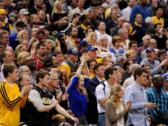Indiana Pacers fans cheer as they take a late lead against the Miami Heat inside Bankers Life Fieldhouse, Wednesday, March 26, 2014, in Indianapolis. The Pacers won the game 84-83.