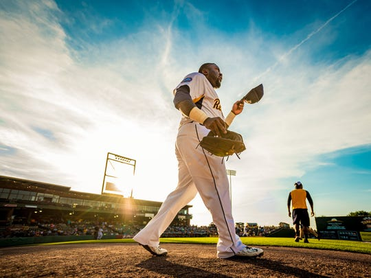 York Revolution right fielder Michael Burgess (21) walks to his position between innings against the Long Island Ducks at PeoplesBank Park on Wednesday.