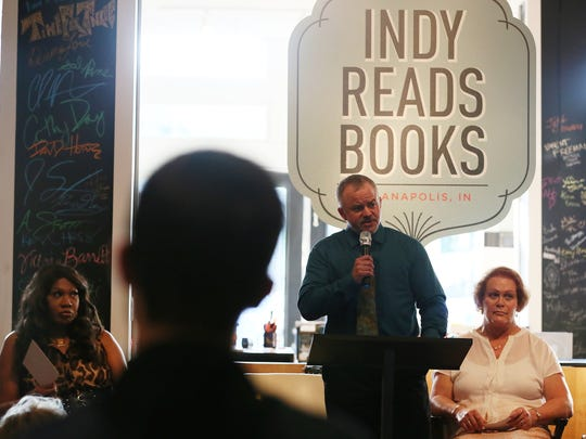 Authors Marissa Miller (left) and Jacqueline Patterson listen as Michael Woodward speaks about his experiences as a transgender man at IndyPride's first Transgender History Night at Indy Reads Books in 2015.