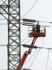 Indiana Michigan Power workers work on this substation