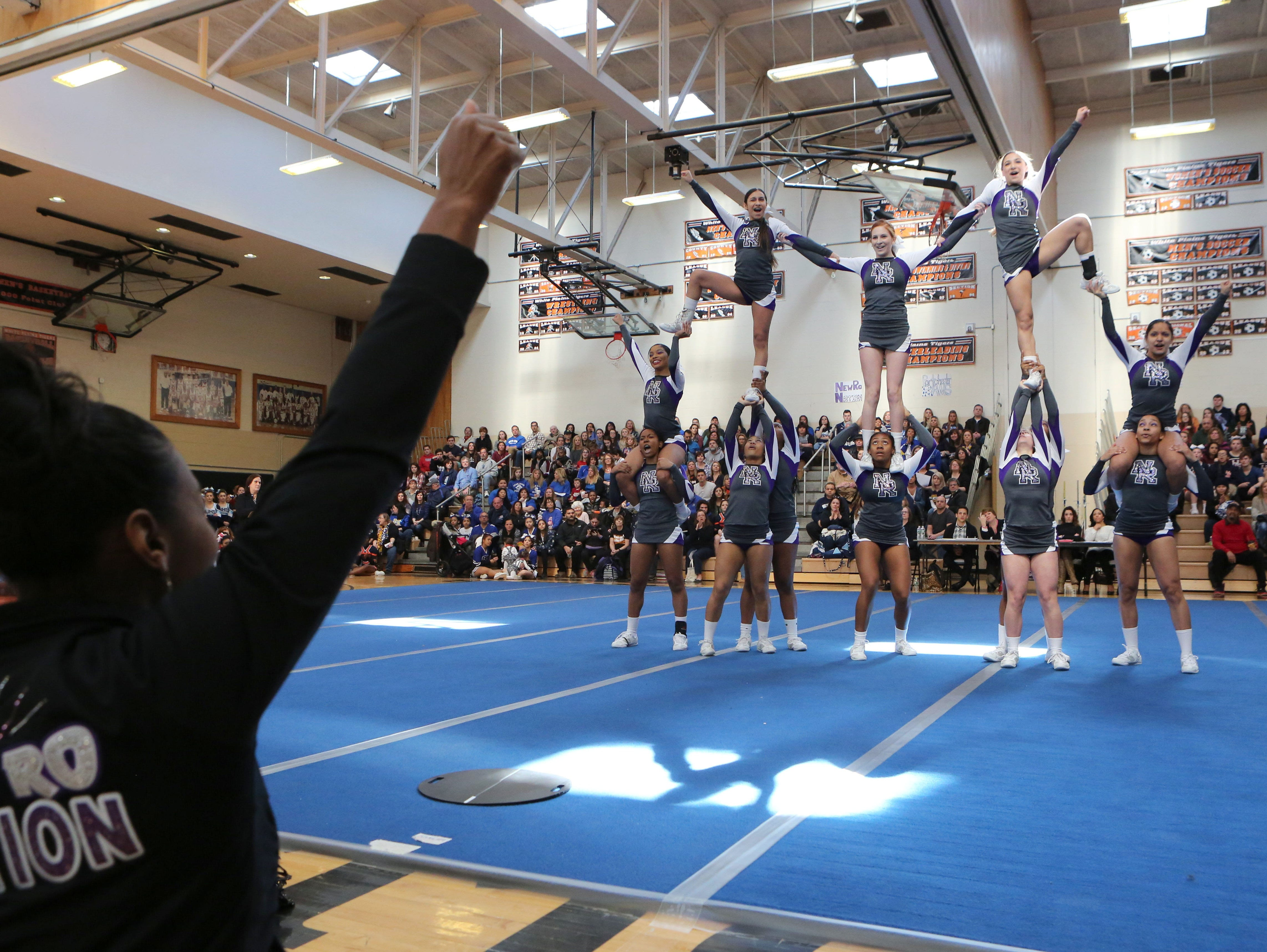 New Rochelle High School cheerleaders perform during the Section One Cheerleading Finals 2016 at White Plains High School, Feb. 27, 2016.