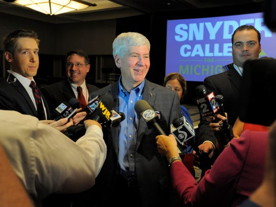 "Gov. Rick Snyder speaks with reporters at the Detroit Marriott at the Renaissance Center during the Republicans'  ""One Michigan"" election night party."