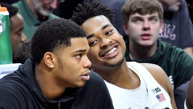 Miles Bridges, left, has remained on the Michigan State bench in walking boot while recovering from an injury.