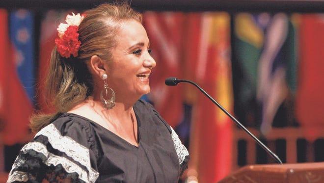 Yolanda Lorge, president of Grupo Latinoamericano, introduces the 25th anniversary celebration of the group at the Plaster Student Union at Missouri State University on Saturday.