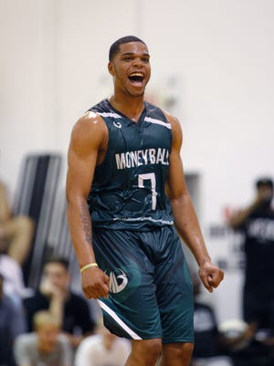 Miles Bridges celebrates during a Moneyball Pro-Am game, Thursday, June 29, 2017, in Dimondale.