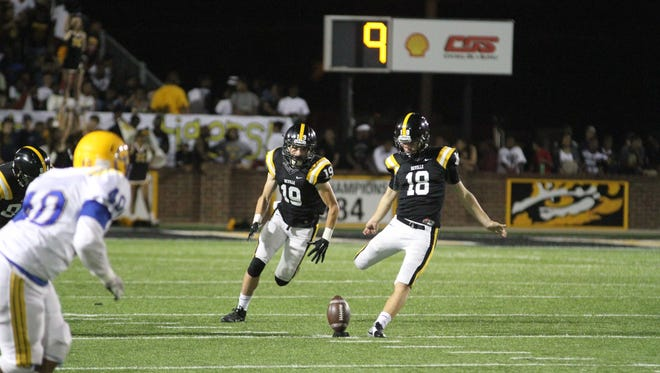 The Carrolll Bulldogs battled against the Neville Tigers on Friday night in Monroe.