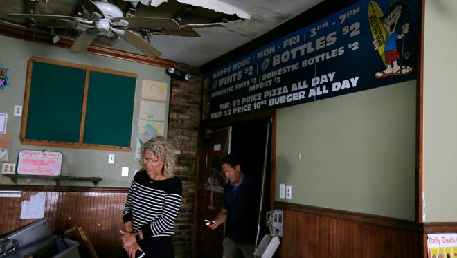 Scott and Amy Kelly, owners of Mad Hatter in Sea Bright, tour the property, which was destroyed by Sandy, Friday June 3, 2016. The owners will go before the planning board for the ninth time to finally get approval to start the rebuild later this month.